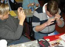 NSTA participant using a Private Eye jeweler's loupe.
